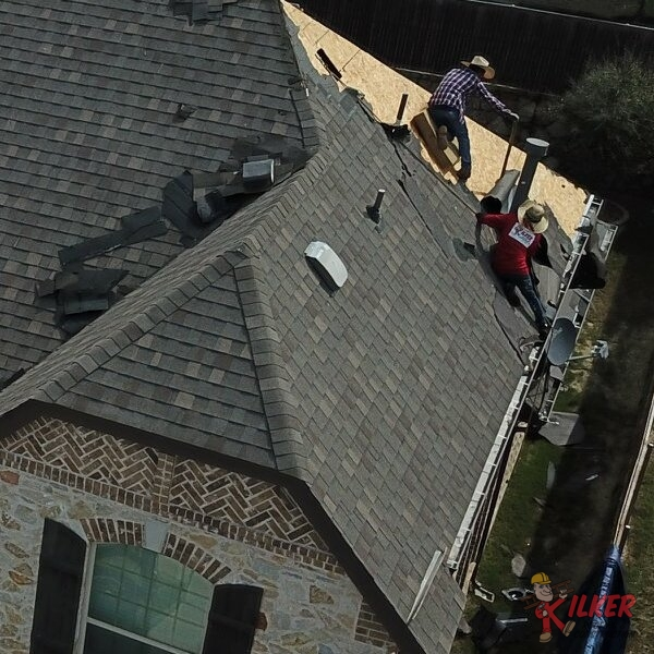 A Kilker Roofing Team Removes Old Roofing Material at a Home in McKinney, TX.