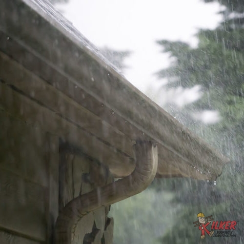 Rain Pouring Down With Close Up Of Roof Corner Gutter & Downspout