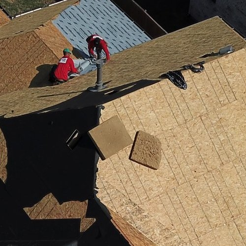Roof replacement, like the one in progress here, is one of our specialties.