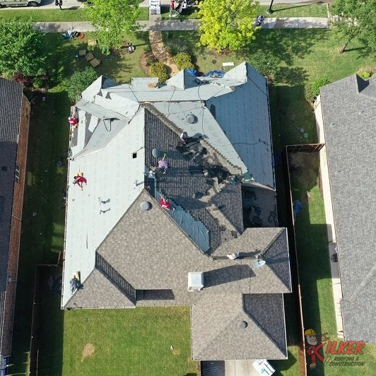 Roofers on a Roof Completed a Replacement